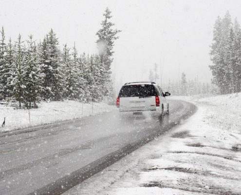 white suv on winter road